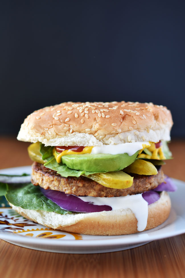 Sol Cuisine veggie burger topped with pickles, avocado #vegan
