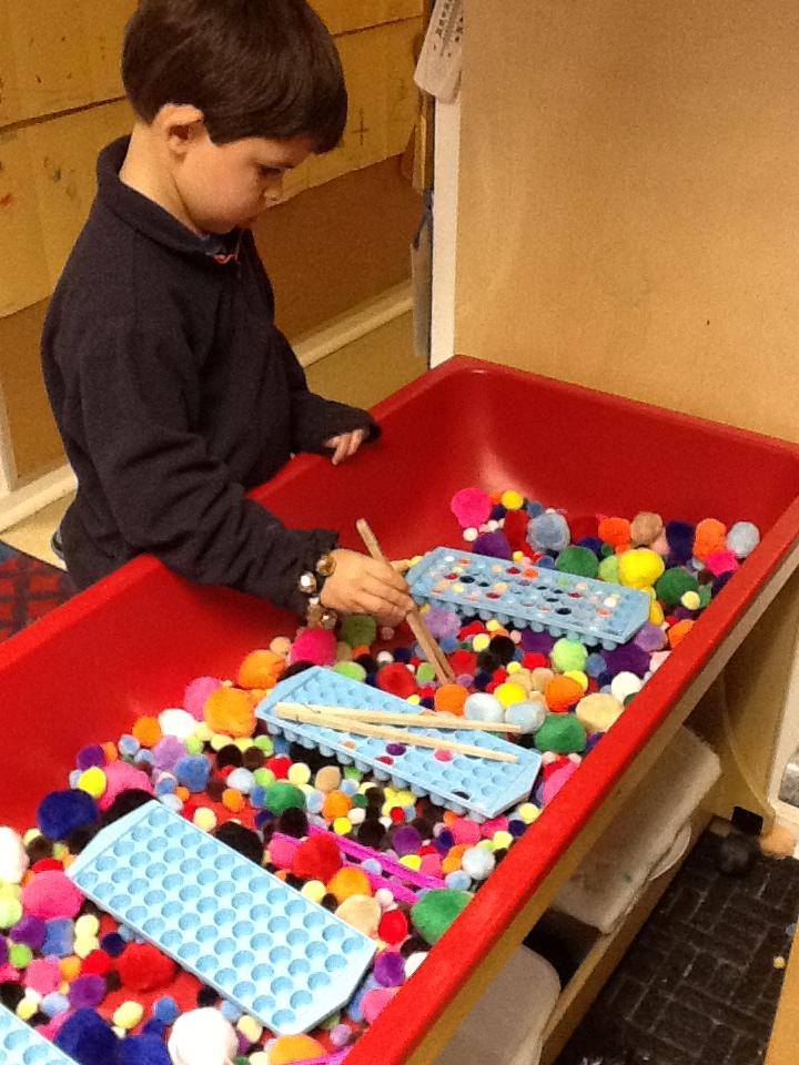 sensory table ideas for preschool playfully learning sensory table idea pom poms 886
