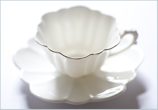 delicate white scalloped teacup