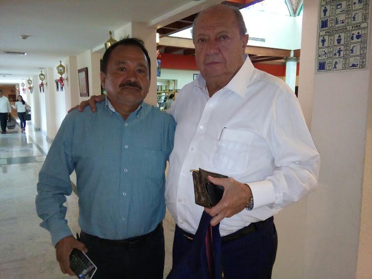 RAUL CASTRO Y EL SECRETARIO GENERAL DE LOS PETROLEROS CARLOS ROMERO DECHAMPS.