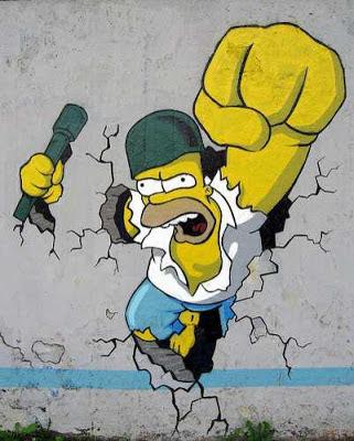 Graffitti de Homero Simpson rompiendo el muro