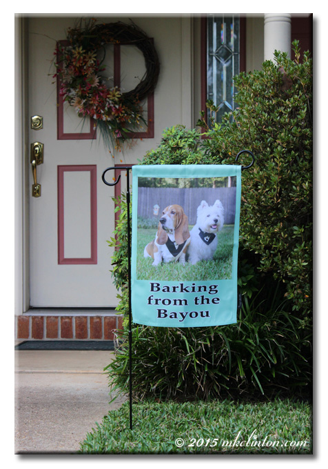 Flagology garden flag with Barking from the Bayou dogs