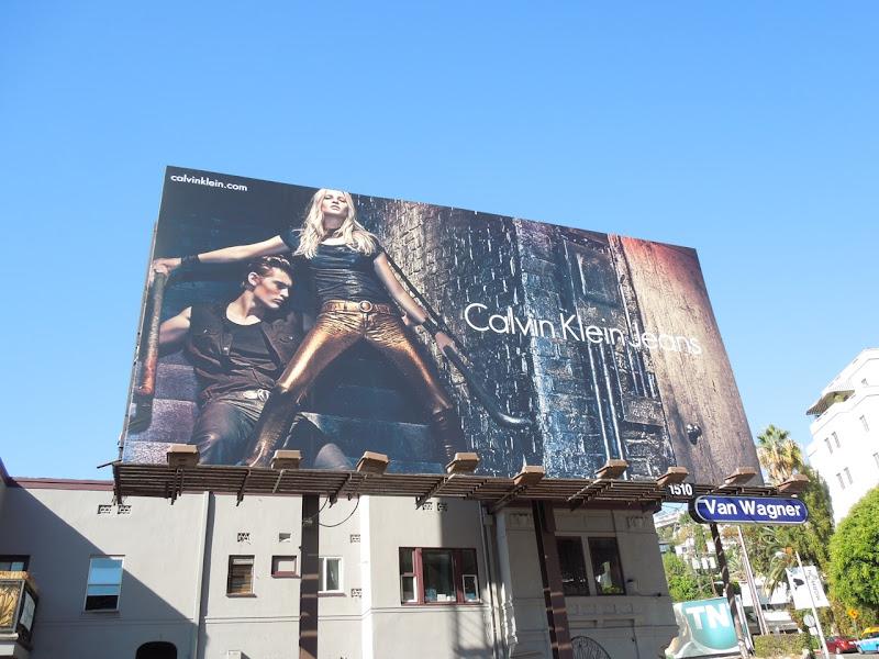 Calvin Klein gold jeans billboard