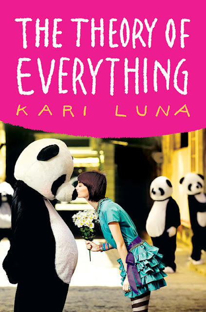 The cover fo the theory of everything has a girl kissing a fuzzy panda