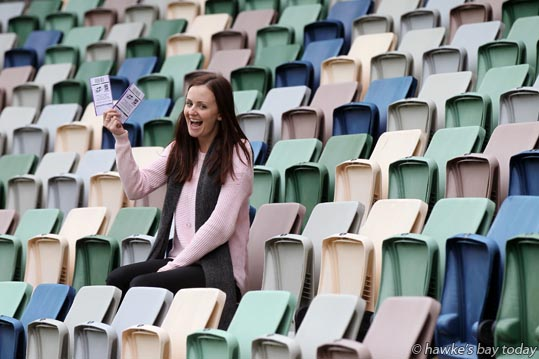 Sam Kershaw, Wellington, ex-Havelock North, match manager for the Hurricanes, holding the last two tickets for  seats in the stands at this Friday's Hurricanes vs Highlanders rugby game, pictured in the Graeme Lowe Stand at McLean Park, Napier. photograph