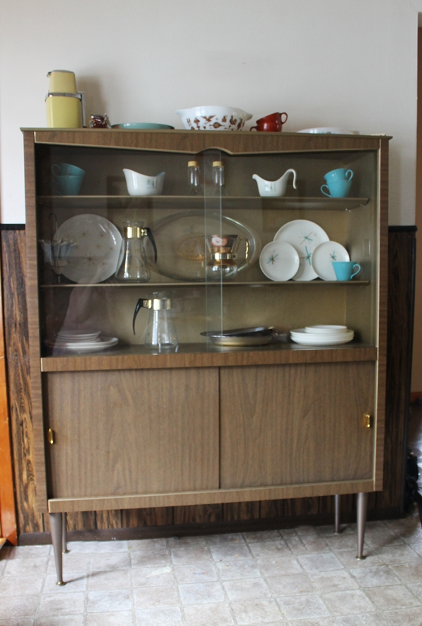 mid century 1950s china cabinet with vintage dishes collection