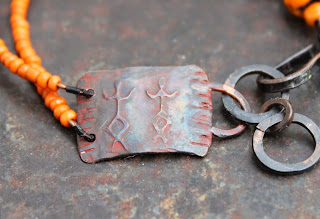 orange shaman rockpainting bracelet etched plate