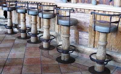 Wooden bar stools at a wooden bar