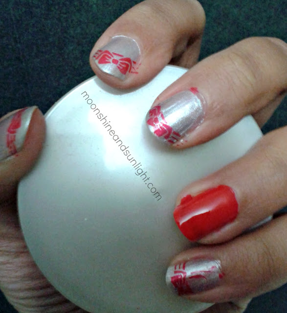 red stamped bow nail art