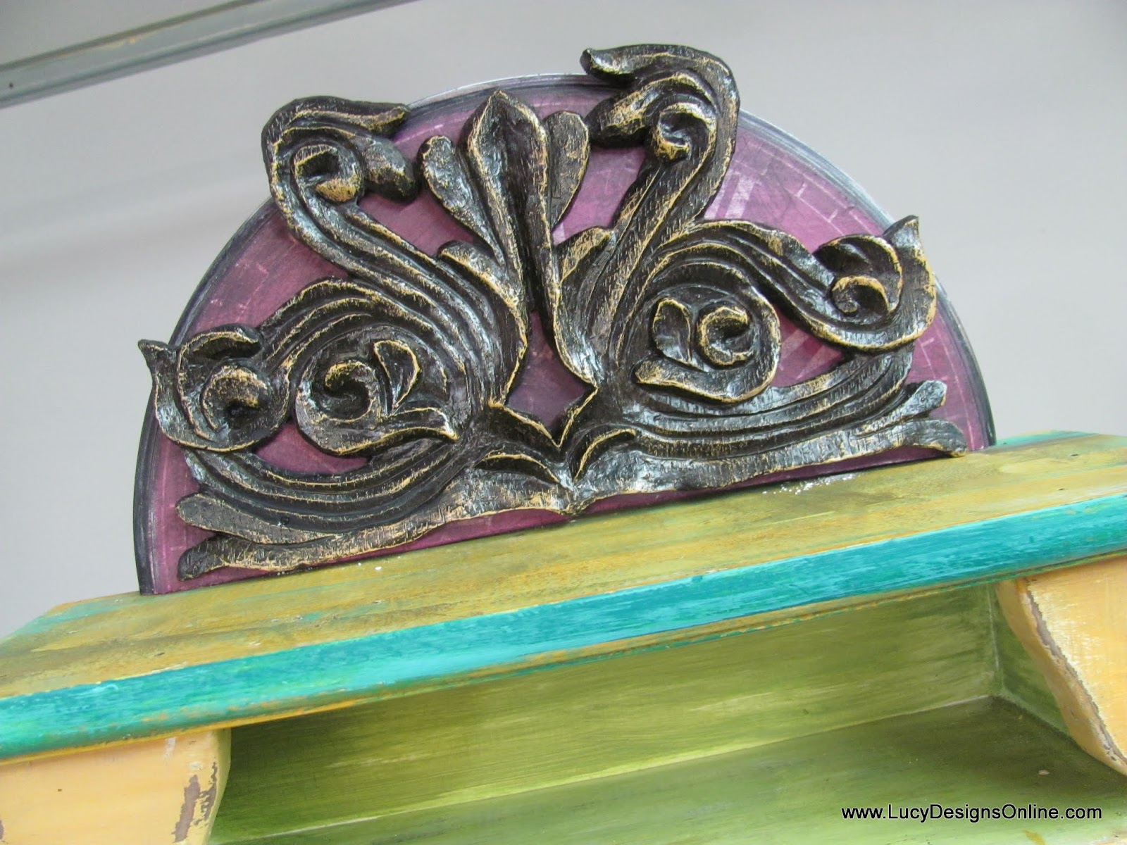 funky pediment on cabinet using repurposed and recycled elements