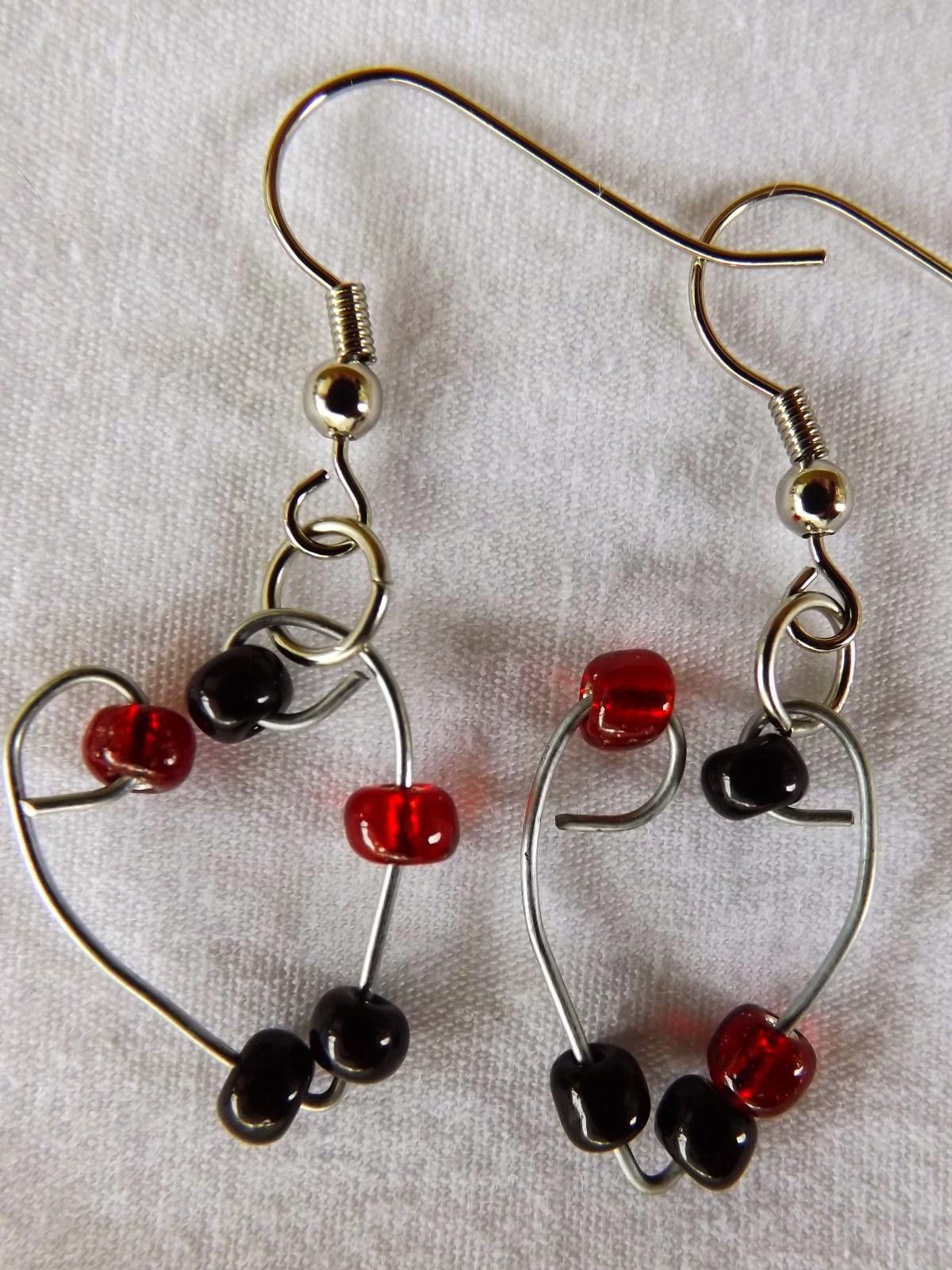 http://www.ebay.com/itm/Single-Heart-Earrings-Handmade-glass-dangle-with-stainless-steel-hook-/261770359867?fb_action_ids=318221801699656&fb_action_types=og.shares