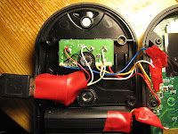 [Image: The receiver opened, showing a USB cable coming in and separating into botchy wires. Electric tape all over.]
