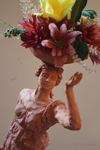 woman, sculpture, bowl, figure, terracotta, ceramic, earthenware, red, Sarah, Myers, flowers, lady, escultura, art, arte, clay, bottle, bouquet, rose, chrysanthemums, mums, yellow, orange, new, artwork, classic, figurative, renaissance, artist, tall, beautiful, spontaneous, kunst, move, walk, stride, arrangement, decor, deco, photography, face, smile, head, hand, lively, detail