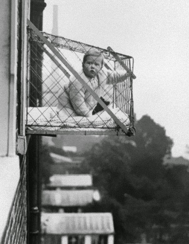 a baby in a window cage