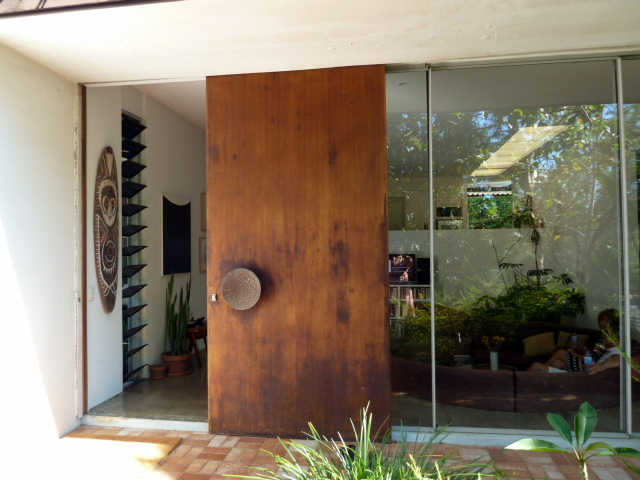 Fun and vjs mid century homes in bardon for Sliding door front door