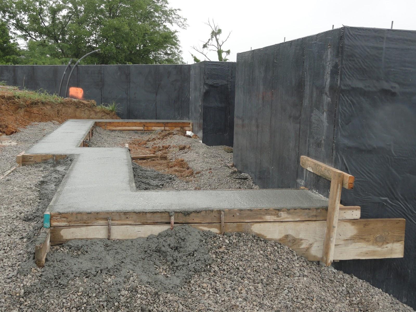 Kamish lake home june 1 the garage foundation takes shape for Foundation for garage