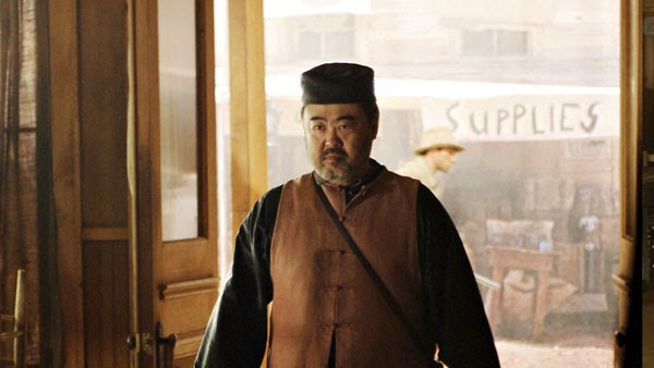 Keone Young as Mr. Wu in Deadwood