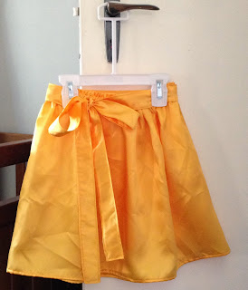 Satin orange skirt with sash
