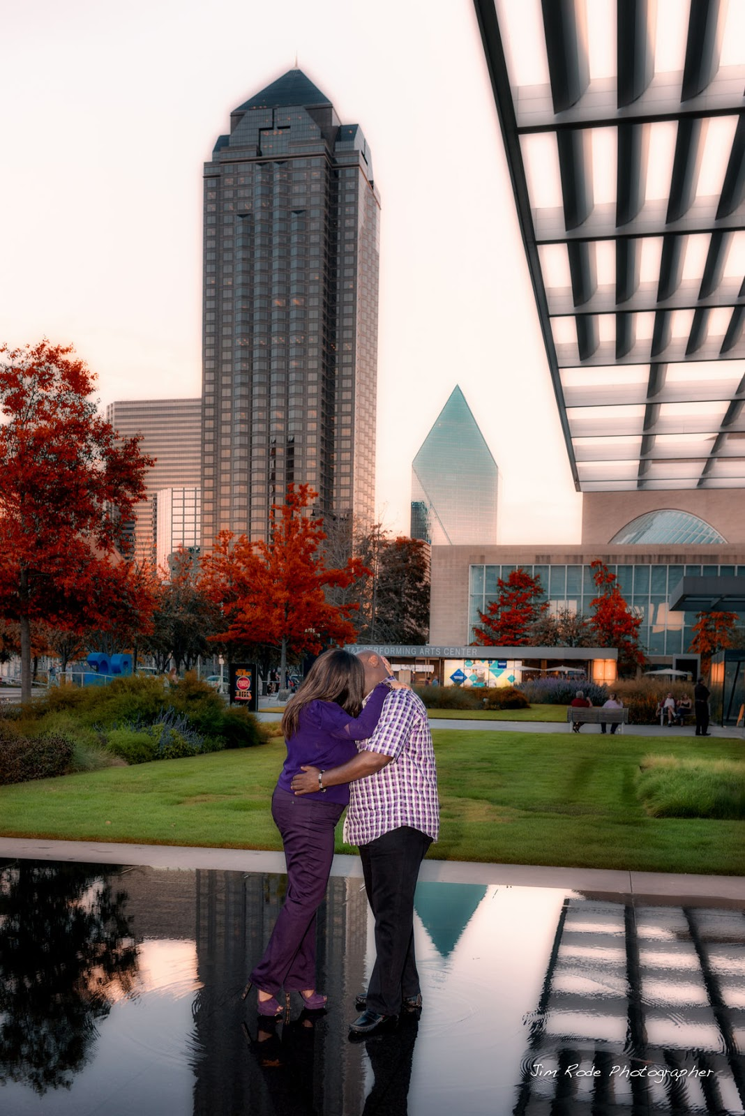 engagement kiss with candy sky in Dallas Arts District