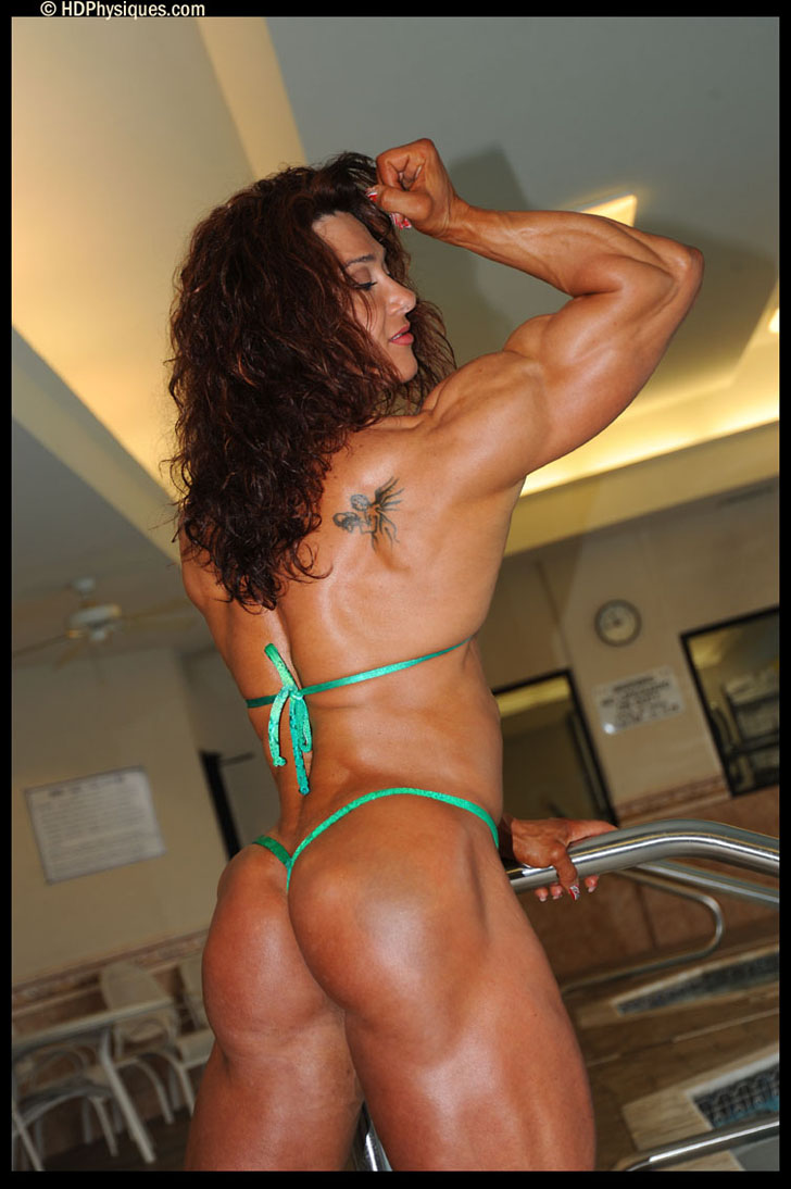 Alina Popa Flexing A Bicep And Posing Her Great Butt