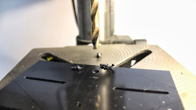 Screw holes are counter-sunk on the middle plate of the camera stabilizer head plate