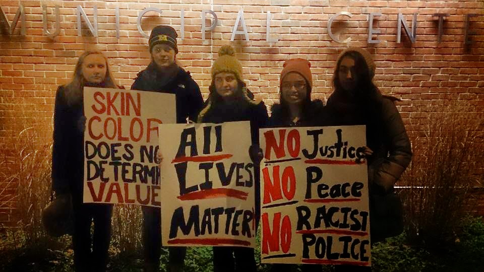 Photo Credit - IU News & Talk Students at the University of Michigan participate in a #BlackLivesMatter Protest in Late November 2014