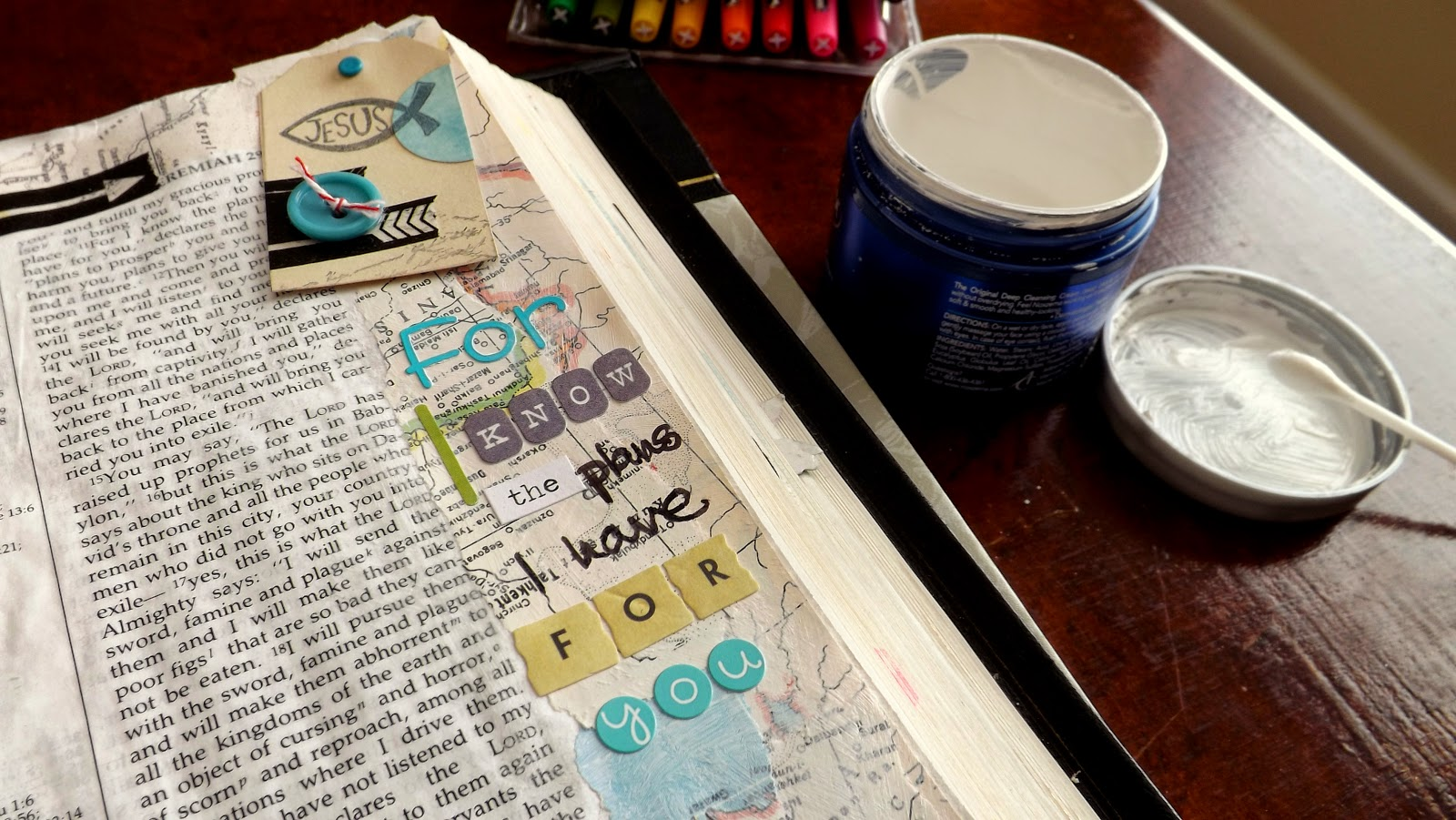 "Art journaling Bible page ""For I know the plans I have for you"" with stickers, map, and gesso"