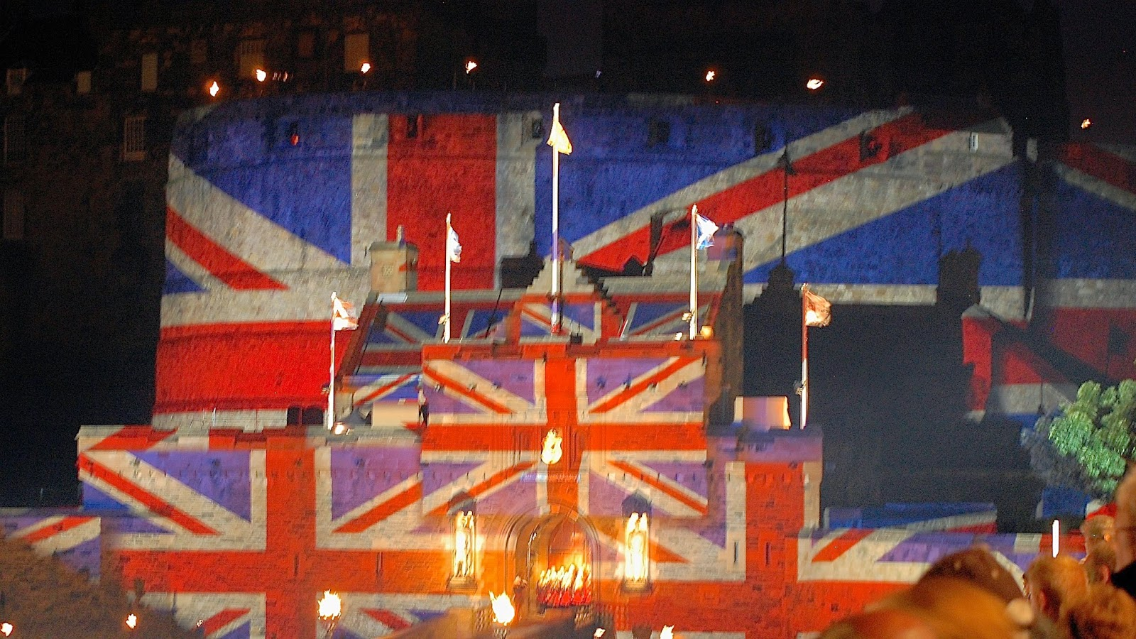 Union Jack flags on Edinburgh Castle during Royal Edinburgh Military Tattoo