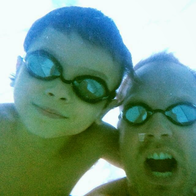Endless Pool Swim Spa owner Ivan Eustace with his 8-year-old son.