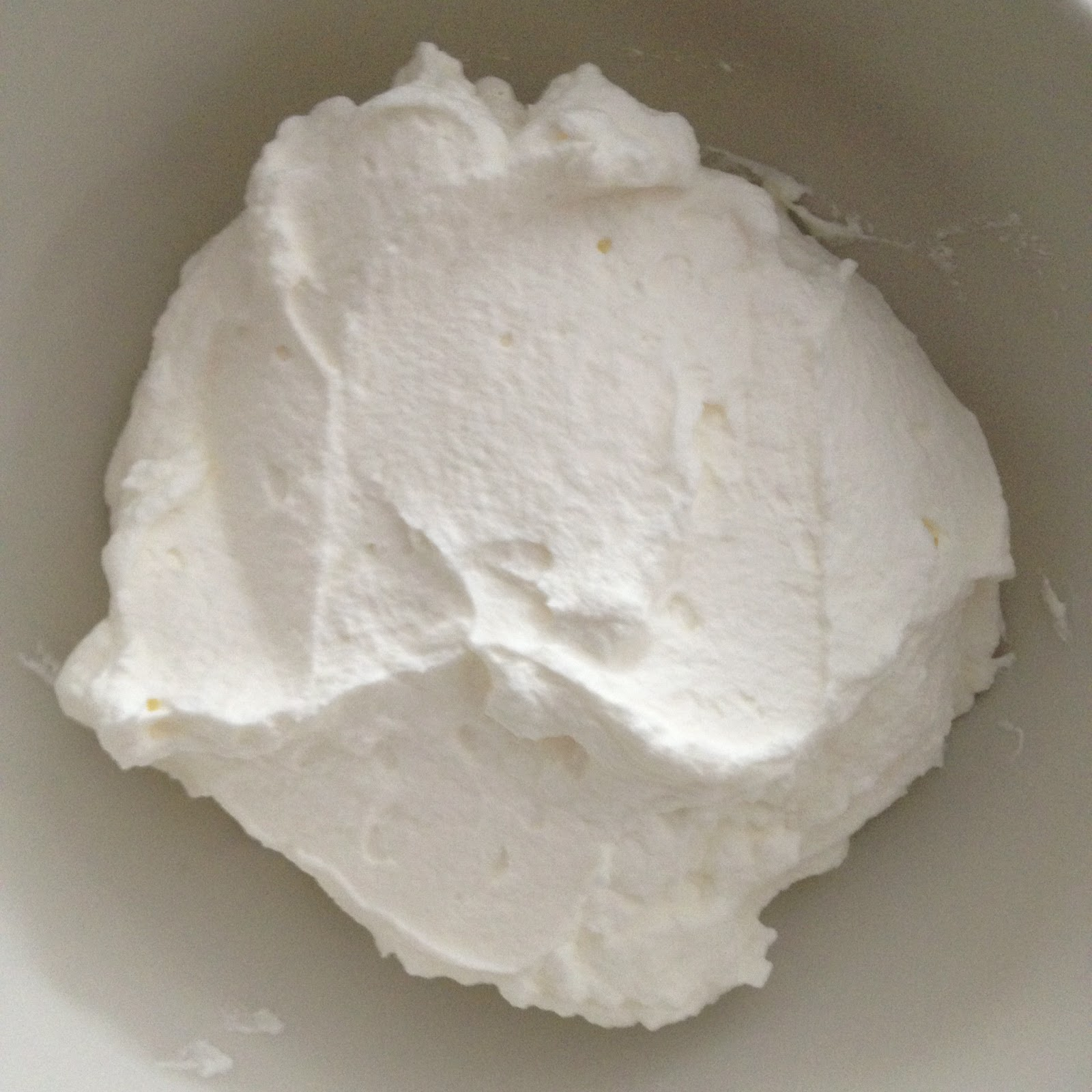 In a medium bowl, whisk whipping cream until fluffy.