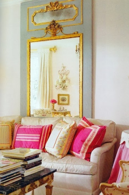 white living room hot pink blue gold accents oversized mirror