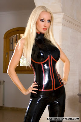 Busty Blonde Saffron Taylor in Black Latex Catsuit