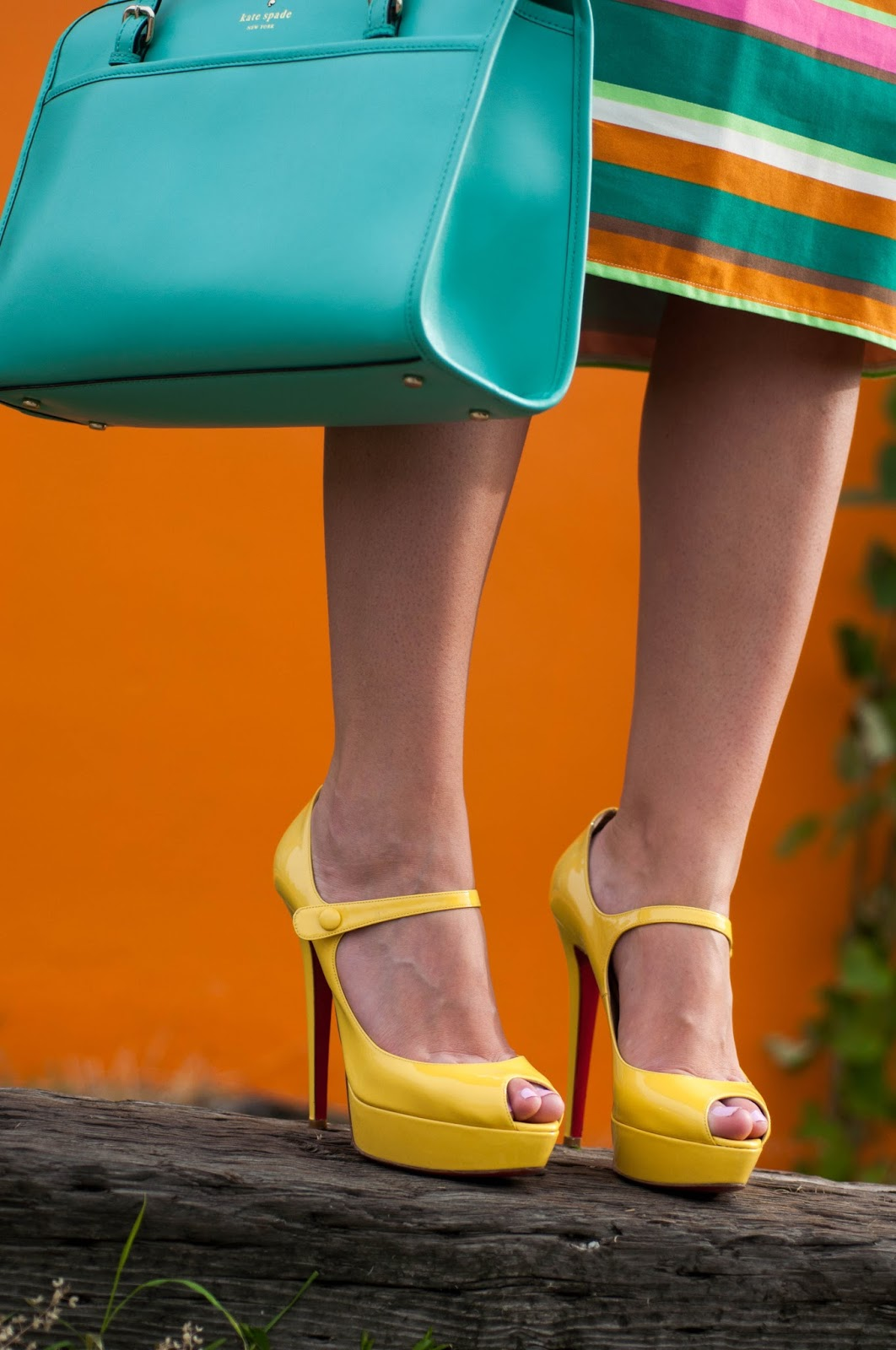 red soles, christian louboutin, yellow heels, kate spade handbag, striped skirt, pencil skirt