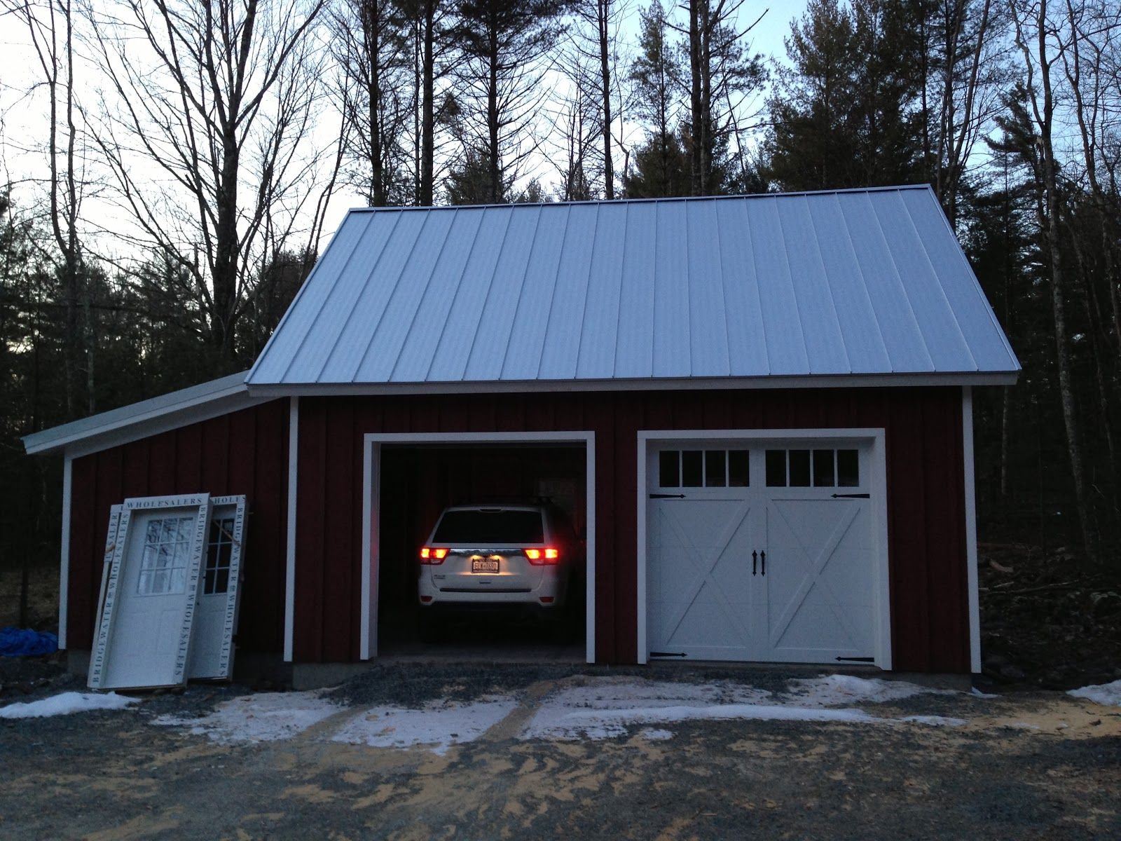 sullivan county ulster county real estate catskill farms wide ribbed metal roof vertical board and batton siding stained barn red yes seriously that s the name cross buck garage doors