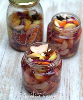 probiotic foods: pickled salad with tart apples, summer carrots and red cabbage