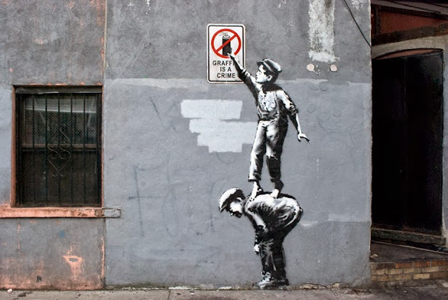 "Street Art By Banksy In Chinatown, New York City, USA ""Better Out Than In"" October 2013."