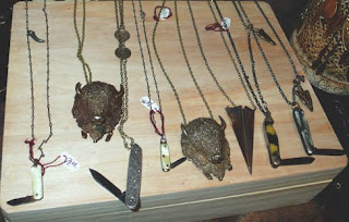 Cutting edge jewelry. Miotal necklaces with pocket knives.