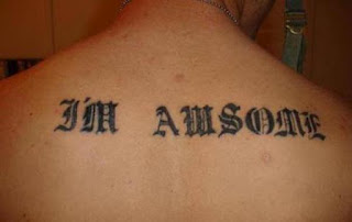 misspelled tattoo on the back: awsome