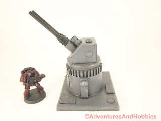 Miniature wargame remote air defense gun turret - side view.