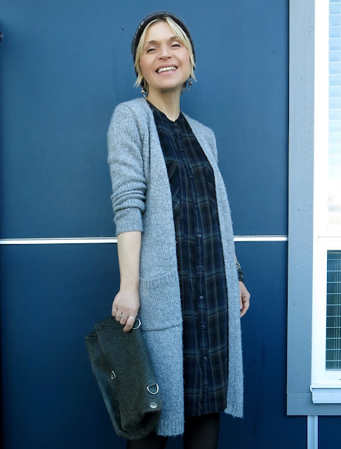 styling a plaid shirtdress with a long cardigan and woolen beanie