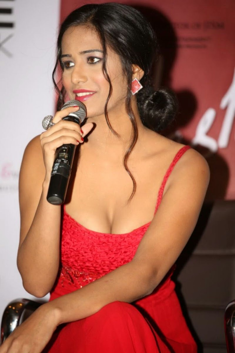 Indian Model and Bollywood Actress Poonam Pandey in Low Neck Tight Orange  Colour Gown Dress a2bae13be
