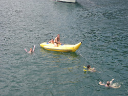 Elsie on a banana boat.  It gets pulled by a speed boat and is very flippy.