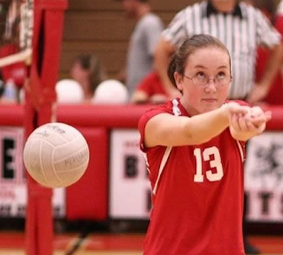 Funny picture, female volleyball player does not see the ball