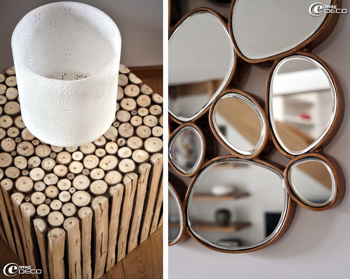Détails d'une petite table carrée composée de rondins de bois et d'un miroir galets