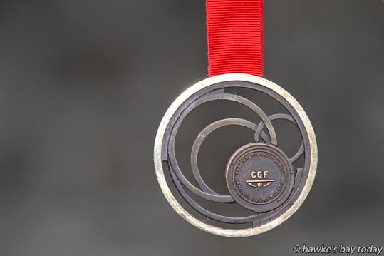 Hockey bronze medal from the Glasgow Commonwealth Games, won by Emily Naylor, Kereru photograph
