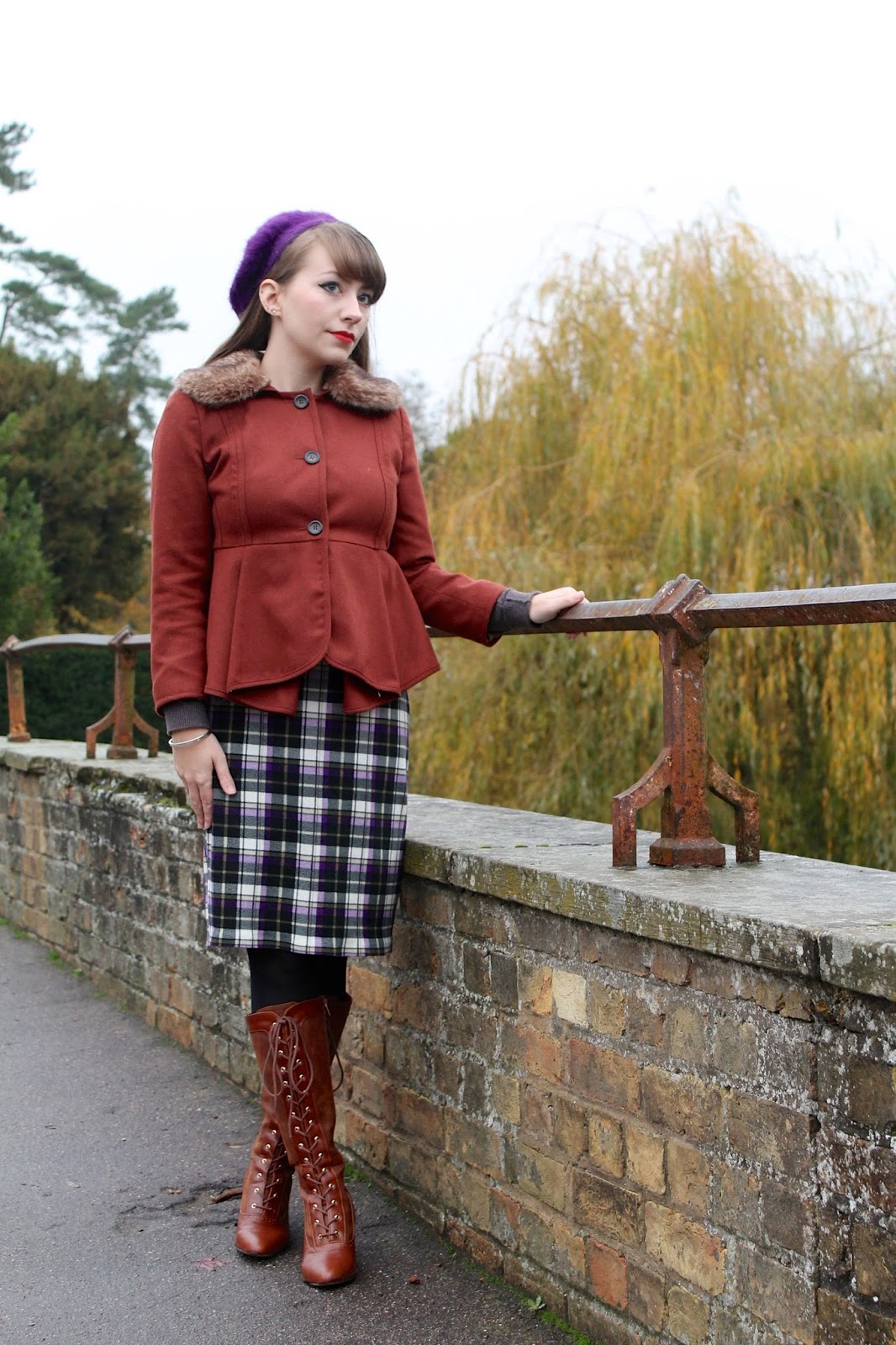 Fluffy beret, fur collared jacket, plaid dress and tan knee-high boots
