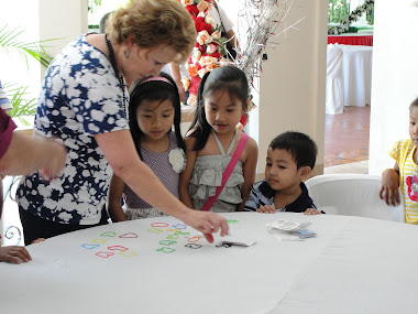 Dr. Mary Grundorf, wife of ABP. Walter Grundorf, spends time with the children of SJV