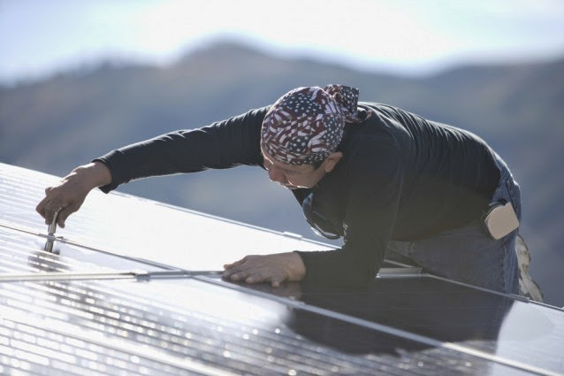 Installing solar panels (Credit: Shutterstock) Click to enlarge.