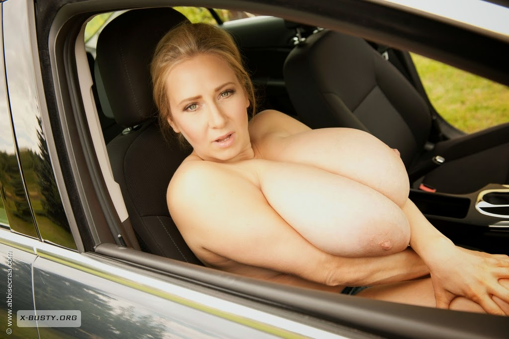Wife with huge tits washing car