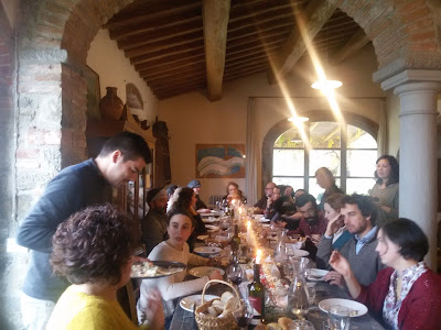 Tommy and Giulia serving the second course during a Tuscan Christmas lunch